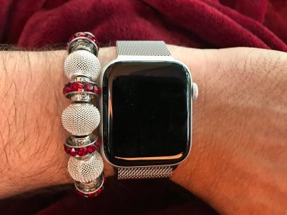 Siam Red Swarovski BeCharmed and Silver Mesh Bracelet on my arm next to an Apple Watch with a stainless steel Milanese loop band.